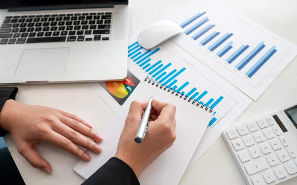 Business people checking charts, spreadsheets, graphs, financial development, bank accounts, economic statistics, data analysis, investment analysis, stock market