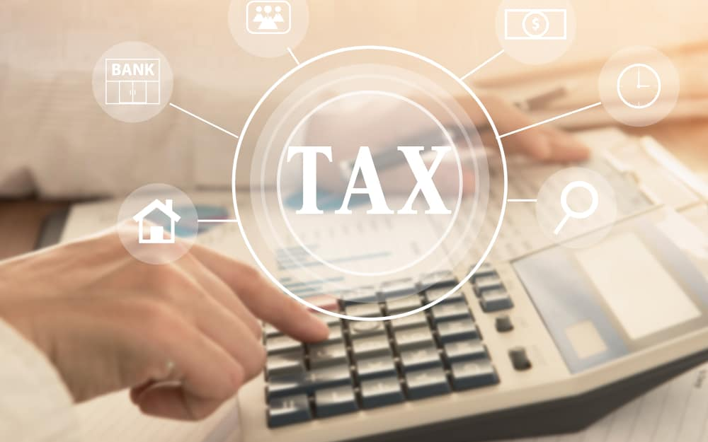 women using calculator calculated individual income tax for pay taxes annual