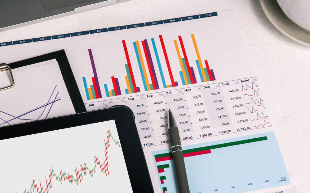 Desktop with documents, tablet and charts. Analytics of the company's activities